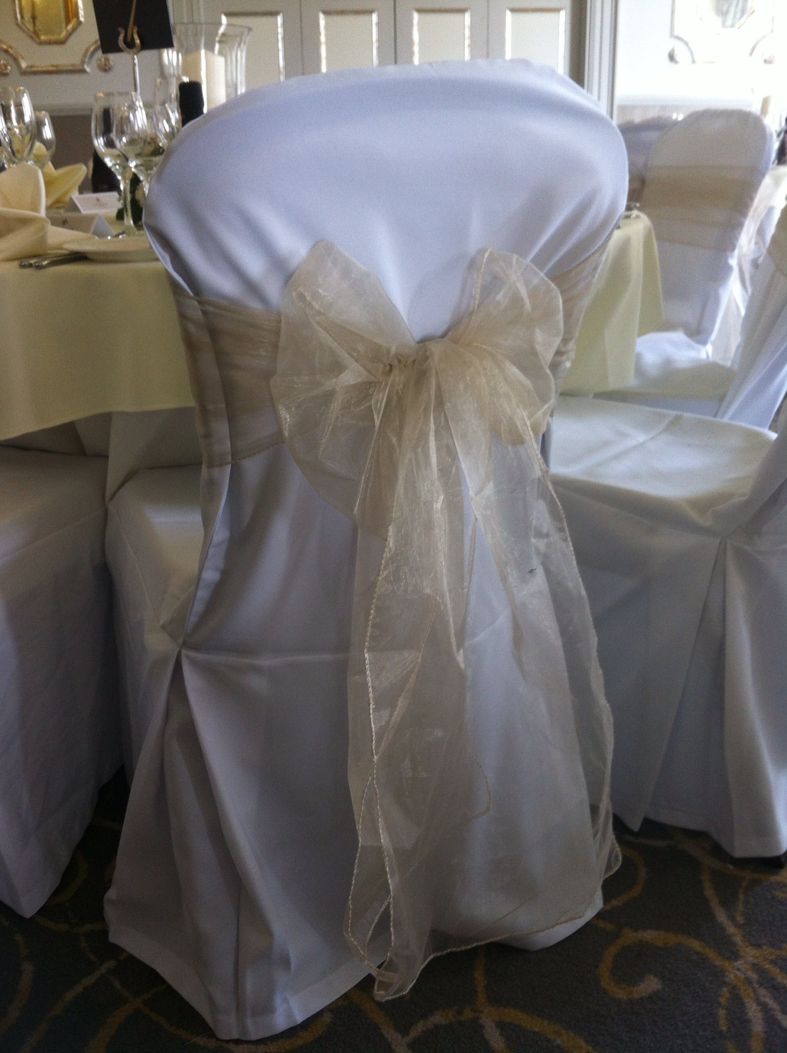 Close House Newcastle Wedding with chair covers and champagne